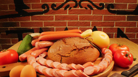 still life with natural sausages rye bread and vegetables Live Action