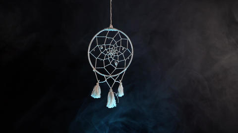 dream catcher on the background of smoke. Mystery and Witchcraft Live Action
