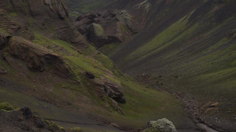 Canyon with different colored layers cliffs and hills Live Action