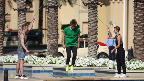 Group of sportsmen jumping with jump rope in Dubai Live Action
