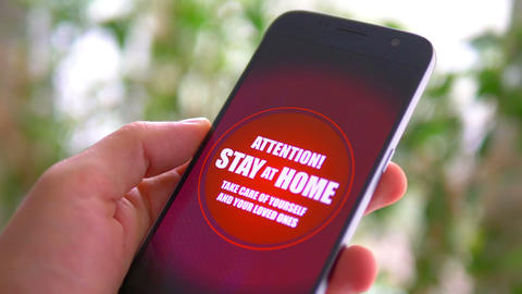 Emergency message Stay Home on the phone GIF