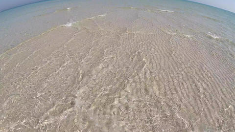 4k slow-motion of Crystal clear water and white sand Live Action
