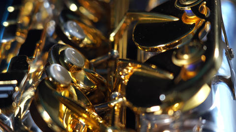 Golden shiny alto saxophone with blue smoke. Concept of muse and creativity Live Action
