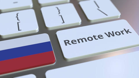 Remote Work text and flag of Russia on the computer keyboard. Telecommuting or Live Action