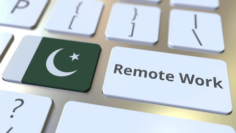 Remote Work text and flag of Pakistan on the computer keyboard. Telecommuting or Live Action