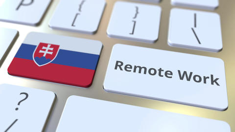 Remote Work text and flag of Slovakia on the computer keyboard. Telecommuting or Live Action