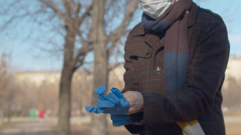 Man putting on protective gloves Live Action