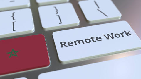 Remote Work text and flag of Morocco on the computer keyboard. Telecommuting or Live Action