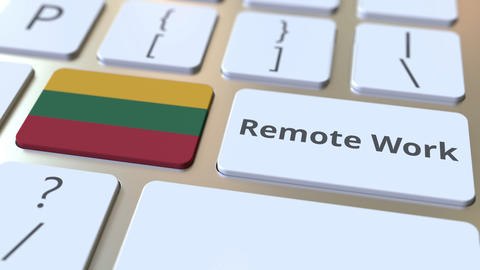 Remote Work text and flag of Lithuania on the computer keyboard. Telecommuting ライブ動画