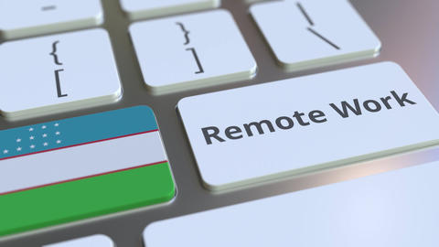 Remote Work text and flag of Uzbekistan on the computer keyboard. Telecommuting ライブ動画