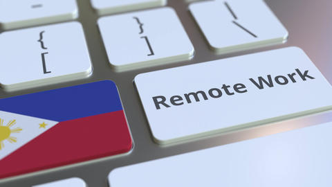 Remote Work text and flag of Philippines on the computer keyboard. Telecommuting Live Action