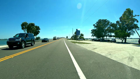 Driving down the road to Sanibel Island - Florida Fort Myers - first person view Live Action