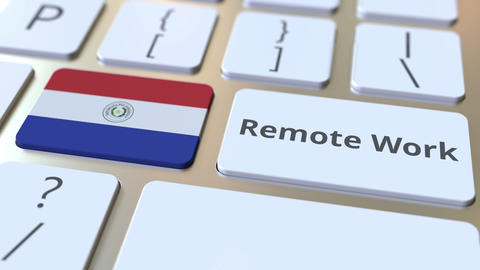 Remote Work text and flag of Paraguay on the computer keyboard. Telecommuting or ライブ動画