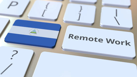 Remote Work text and flag of Nicaragua on the computer keyboard. Telecommuting Live Action