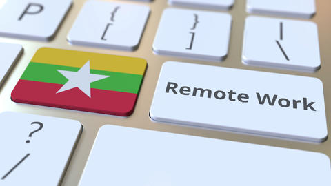 Remote Work text and flag of Myanmar on the computer keyboard. Telecommuting or ライブ動画