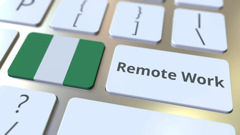 Remote Work text and flag of Nigeria on the computer keyboard. Telecommuting or Live Action