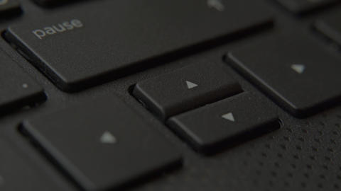 The finger presses the Down button on the keyboard Live-Action