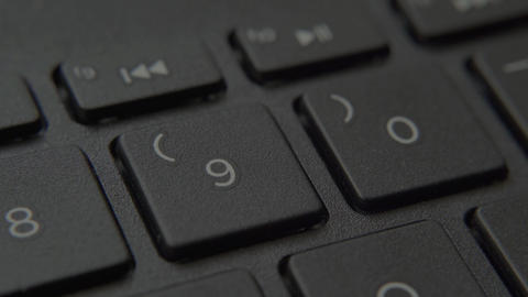 The finger presses a button with a number on the keyboard Live-Action
