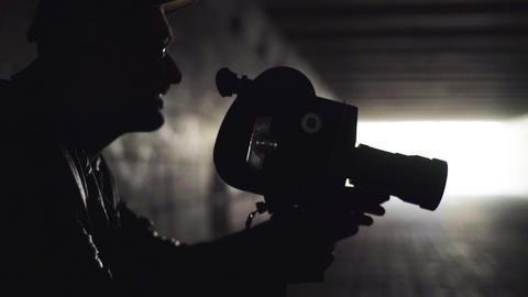 A male cameraman shoots video on an old vintage camera Krasnogorsk. Kyiv Live-Action