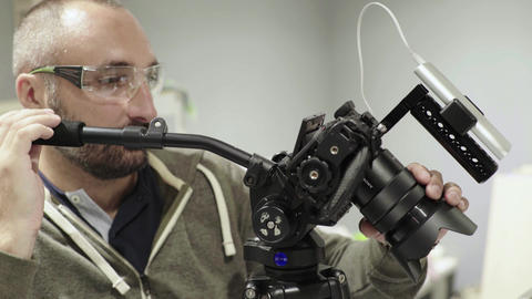 Close-up of a DSLR camera in the hands of a cameraman photographer while Live-Action