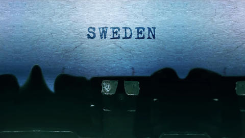 Sweden words Typing on a sheet of paper with an old vintage typewriter Live-Action