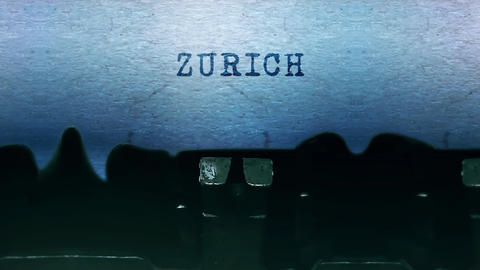 ZURICH words Typing on a sheet of paper with an old vintage typewriter Live-Action