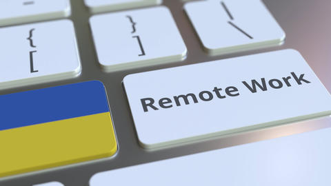Remote Work text and flag of Ukraine on the computer keyboard. Telecommuting or Live-Action