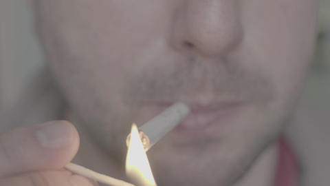 Cigarette in the mouth of a smoker. Close-up Live Action