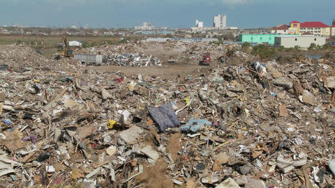 Junk is piled up in the wake of the devastation of... Stock Video Footage