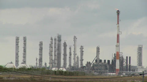Fire burns at an oil refinery Footage