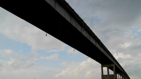 A time lapse shot of a raised bridge with clouds behind Stock Video Footage
