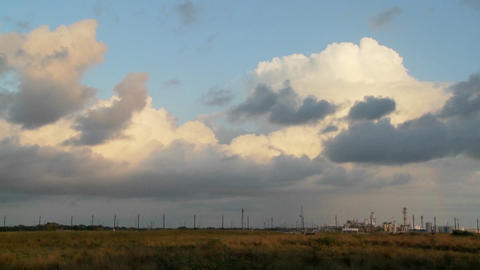 Time Lapse of clouds over an oil refinery Stock Video Footage