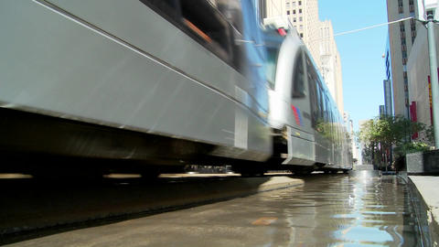 A rapid transit train moves quickly through downtown... Stock Video Footage