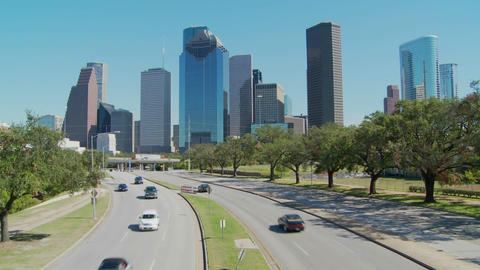 Cars drive along a highway leading into downtown Houston Footage