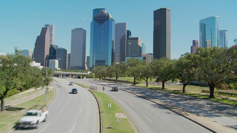 Cars drive along a highway leading into downtown Houston Stock Video Footage