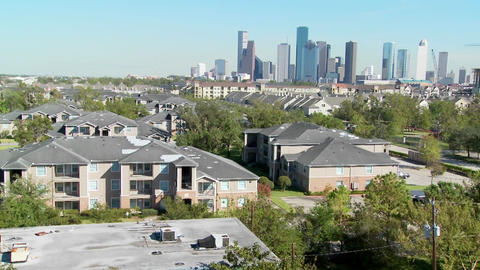 A suburban area of Houston with the downtown distant Footage