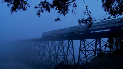 An Amtrak passenger trains speeds across a bridge in the... Stock Video Footage