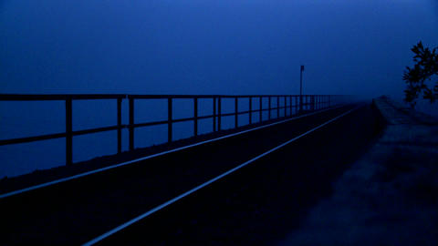 Railroad tracks at dusk Stock Video Footage