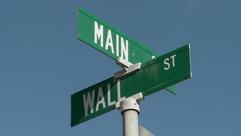 A street sign indicates the intersection of Main and Wall... Stock Video Footage