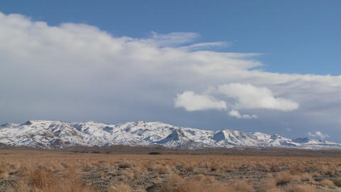 Time lapse over snowclad hills in the Nevada desert Footage