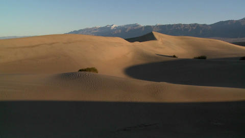 A telephoto shot across the desert dunes at Death Valley Stock Video Footage