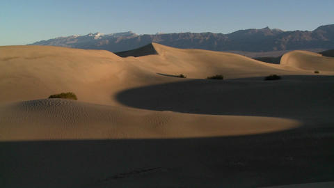 A telephoto shot across the desert dunes at Death Valley Footage