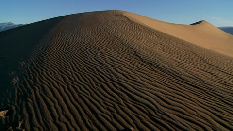 Slow pan across desert dunes in Death Valley National Park Stock Video Footage