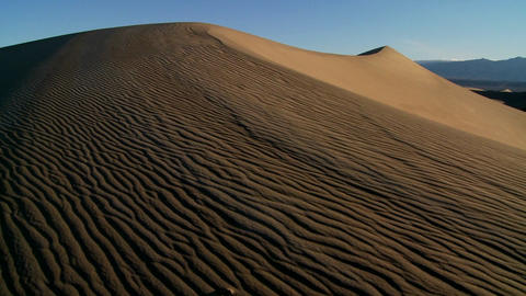 Slow pan across desert dunes in Death Valley National Park Footage