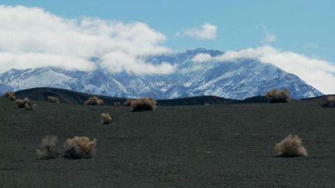 Clouds move over snowbanks in the desert in Death Valley... Stock Video Footage