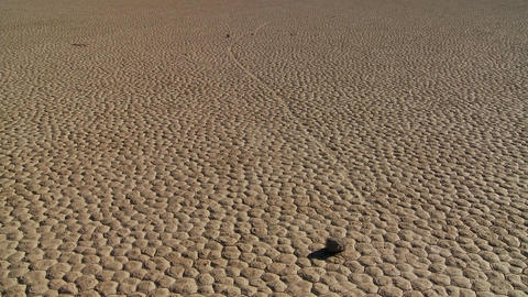 The mysterious rocks which race across the dry lakebed... Stock Video Footage