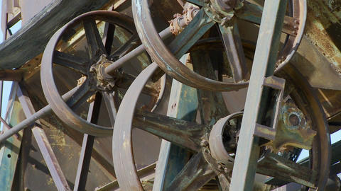 Old cogwheels rust in the sun at an abandoned mine Stock Video Footage