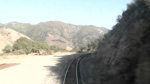 An exciting point of view shot from the front of a train going through many tunnels at high speed Footage