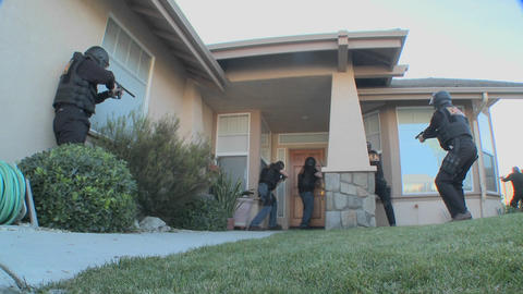 DEA Officers With Arms Drawn Perform A Drug Raid On A House stock footage