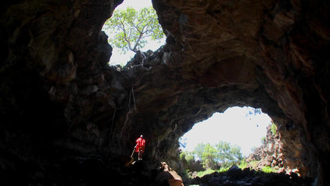 A Masai warrior standing in a deep cave in Kenya Footage